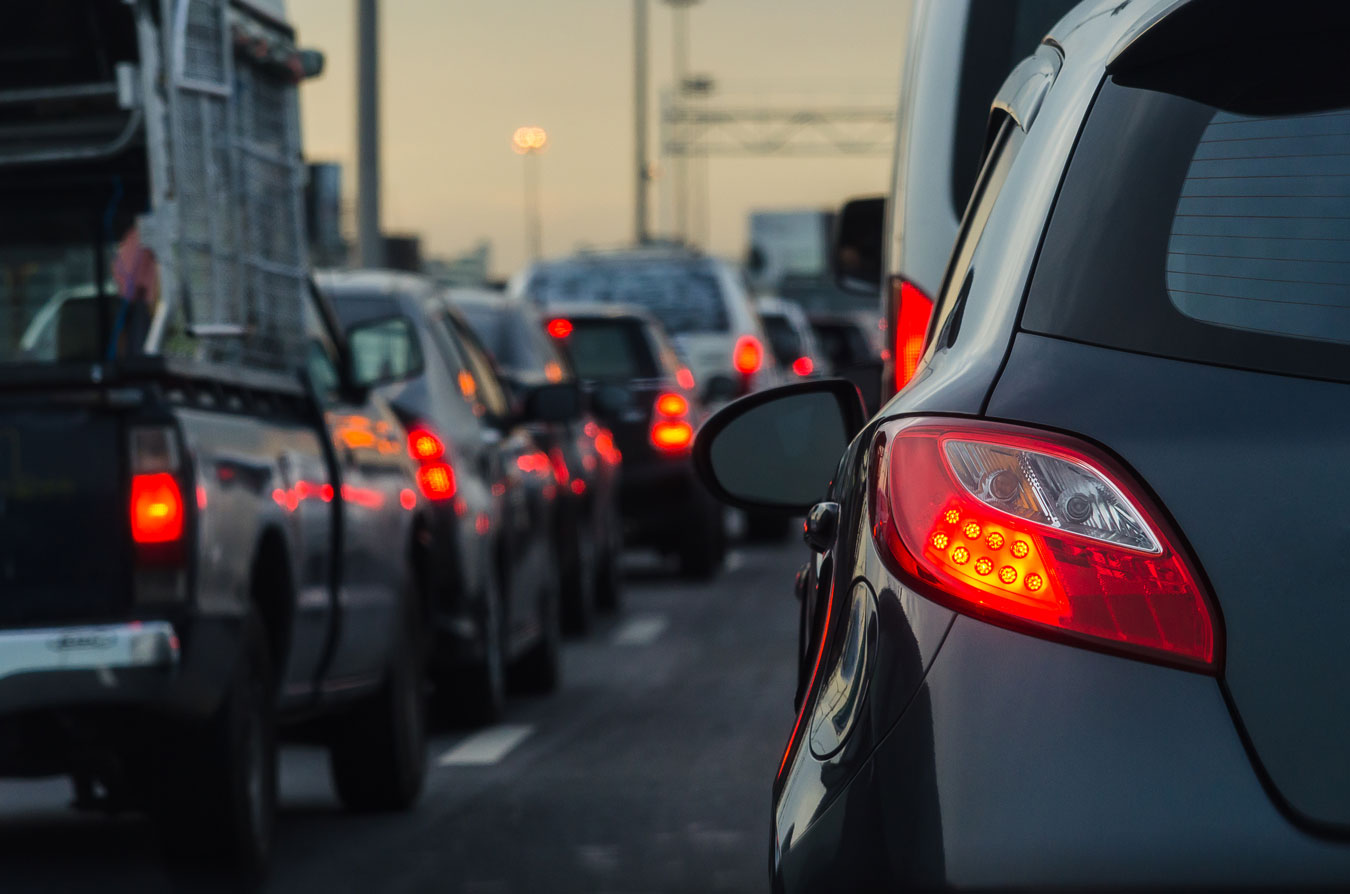 Photograph of rear of cars in traffic