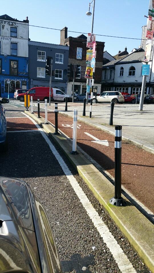 Footpath bollards street furniture separating traffic from cyclists bike path