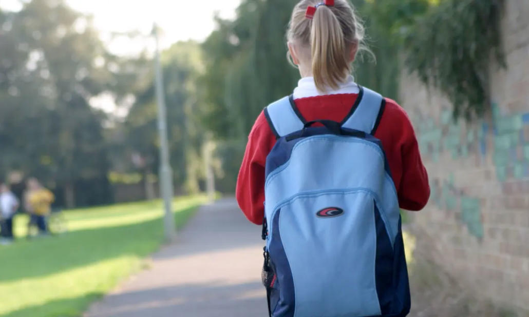 Young girl walking to primary school